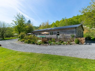 Photo for Surrounded by the hills and trees of the Hafren Forest, this cosy and well-equipped cabin has wonder