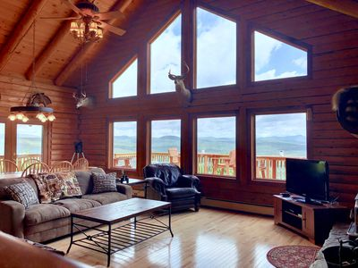 Photo for INCREDIBLE VIEWS from this log cabin with large deck, huge yard, fire pit, hot tub, minutes from skiing, Santa's Village, and all that Northern New England has to offer! Close to snowmobile trail.