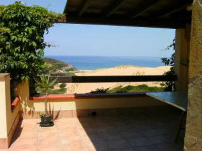 Photo for Spacious terrace with panoramic sea view and sand dunes