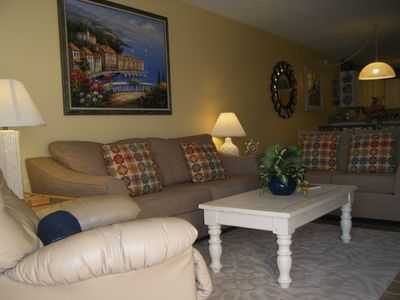 Living room with rocker/recliner & queen sleeper sofa (foam topper available).