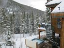 Older photo showing the hot tub view in ski season.