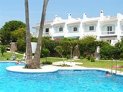 Photo for Villa Set In Beautiful Gardens With A Large Communal Pool With Sea Views