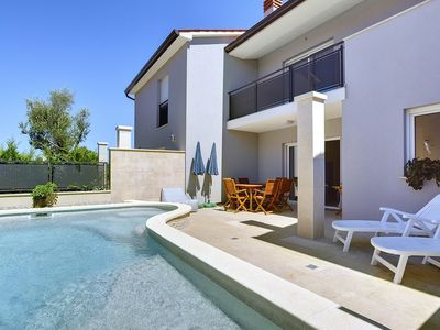 Photo for Beachfront villa with private pool and climate, WiFi, terrace, grill - ideal for a perfect family vacation