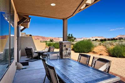 Back Patio Dining Table View - BBQ your favorite dish and eat on the patio table while enjoying the view.