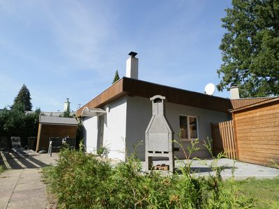 Photo for Modern holiday home in a quiet location on the lake, with fireplace, pets allowed