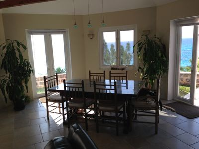 Dining room with unobstructed views of the sea.