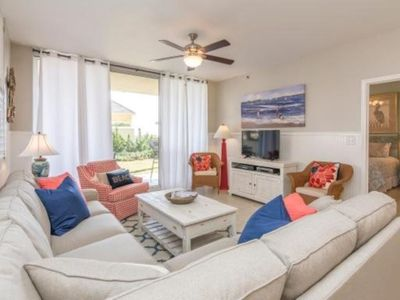 HDTV & Wifi.  Living room opens to the patio which leads to the pool & beach!