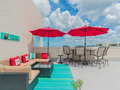 Photo for Oct Kayak Special! Penthouse w/rooftop patio & Sunset Views! Dolphin Watching!