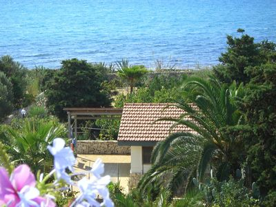 Photo for Quiet holiday home by the sea with sea view