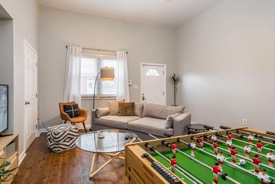 Yes, that's a Foosball table in the living room. Would it be the Fun House if it