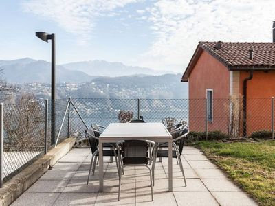Photo for Hillside apartment with garden and wonderful lake view - VERNATE APARTMENT