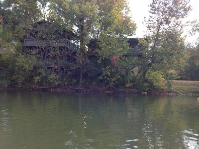 Photo for THE OUTPOST. Secluded cabin on river and creek on 8 1/2 acres. No cleaning fee.