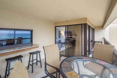 Balcony / Lanai with bar window that opens to the kitchen.