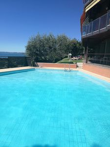 Photo for Comfortable Apartment with pool and fantastic views of Lake Garda.