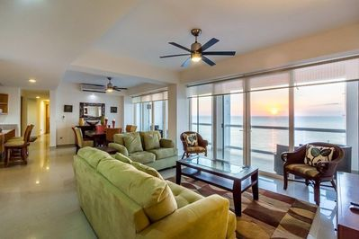 The living room has wonderful views of the ocean from the 11th floor