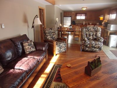 Spacious living room with brand new furniture and reclaimed tables.