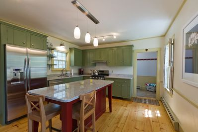 Renovated kitchen with handsome granite counters & island & stainless appliances