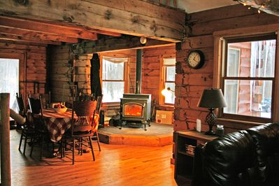 Families rave about the cozy woodstove &  large dining table in our dining area
