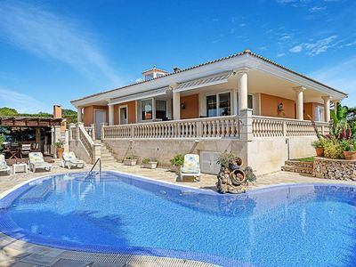 Photo for 4 bedroom Villa, sleeps 8 in Punta Prima with Pool, Air Con and WiFi