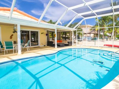 Photo for Updated Ground Level Home near Sombrero Beach with private pool and dockage!