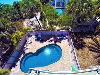 View of the pool and Gulf of Mexico from the upstairs lanai
