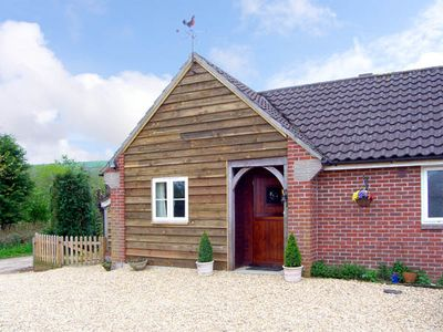 Photo for THE OLD TACK ROOM, pet friendly, with a garden in Ibberton, Ref 2980