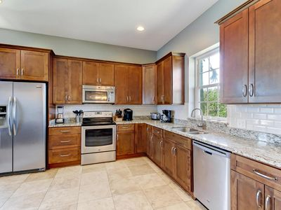 Large kitchen with granite counter tops and stainless appliances