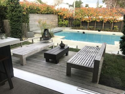 pool area from kitchen/dining in autumn