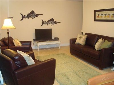 Living room with new furniture, flat screen TV and DVD player