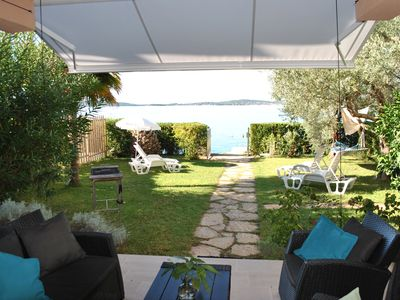 Photo for Bright, spacious beach villa with private sea access, boat dock and garden