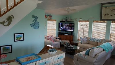 Big fluffy couches, large screen TV, DVD and Bose Audio system with Bluetooth