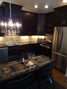 Upscale Kitchen with ice-maker, dishwasher and more.