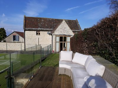 Rear aspect of 'The Dove Barn and social area overlooking tennis court.