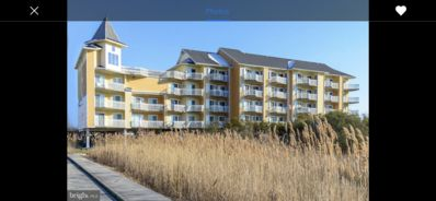 Photo for Bay front condo with amazing sunsets and roof top pool. Two blocks to the beach!