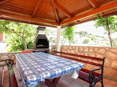 Photo for Two bedroom apartment with terrace and sea view Kampor, Rab (A-4972-b)