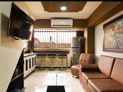 Photo for Hot Tub 1 Bedroom AC wifi washer and dryer.  1 block from Park poblado