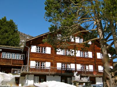 Photo for Luxury 190m2 ski apartment in famous Carl Zuchmayer's Saas Fee chalet