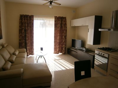 Photo for Completely furnished, newly renovated apartment - 3-min. to the beach promenade