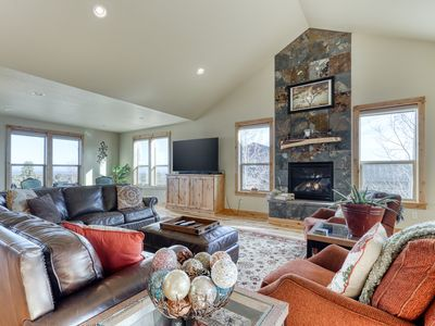 Photo for Gorgeous dog-friendly home w/ mountain views, private hot tub & shared pool!