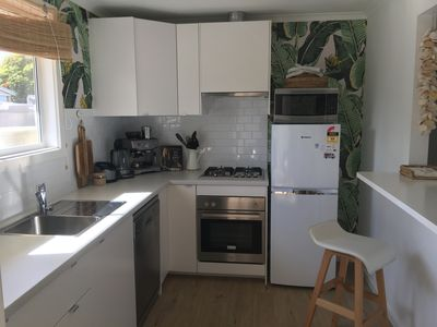 Well equipped kitchen with gas cooktop and electric oven