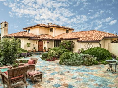 Photo for Posh 3BR w/ Lush Courtyard, Outdoor Fireplace & Brick Oven - Blocks to Beach