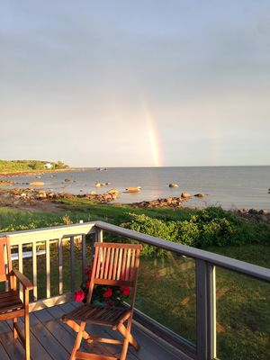 Photo for Beachfront!  Beautiful, cozy, sunny cottage with large decks, views, sunsets.