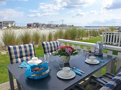 Photo for Modern luxury holiday home with water view, beach access, terrace, sauna & WiFi