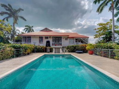 Photo for Breezy cottage with shared pool moments from the ocean and city sights!