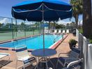 Atlantis amenities include a heated pool and lighted tennis court.