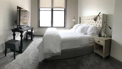 "Master bedroom-55"" TV, Restoration Hardware bed and King Saatva luxury mattress."