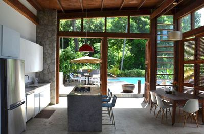 The kitchen doors open to the pool deck and al fresco dining.