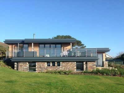 Photo for This exceptional, timber framed eco-lodge boasts magnificent coastal views.
