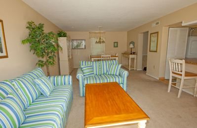 Seascape Villas 3036 - Living Room  and dining room - You'll find the living room and dining room on the main level to be quite spacious and offer brand new furnishings. Sliding glass doors located just off the living room open to a large deck .