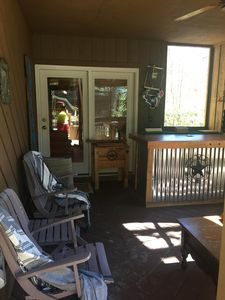 Private screened front porch with fully functional bar.